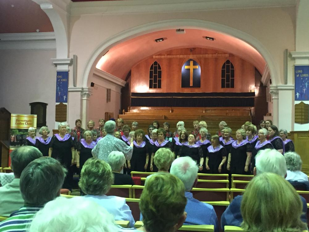 The combined choirs sing together for the final item